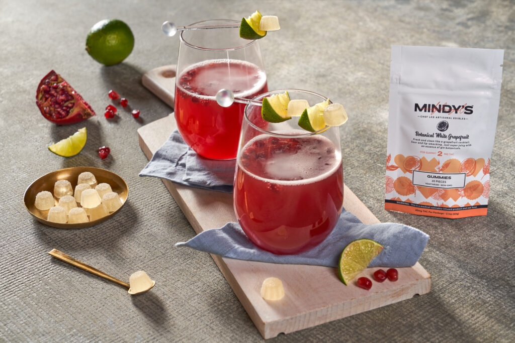 pomegranate drink in a clear cup with mindy's white grapefruit gummies